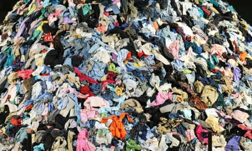 pile of clothing in a landfill
